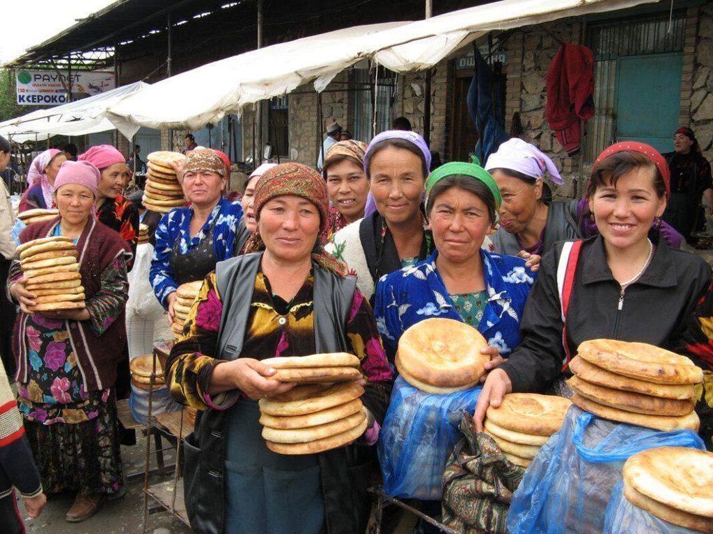 Uzbek women selling bread in Urgut Sunday market, Uzbekistan